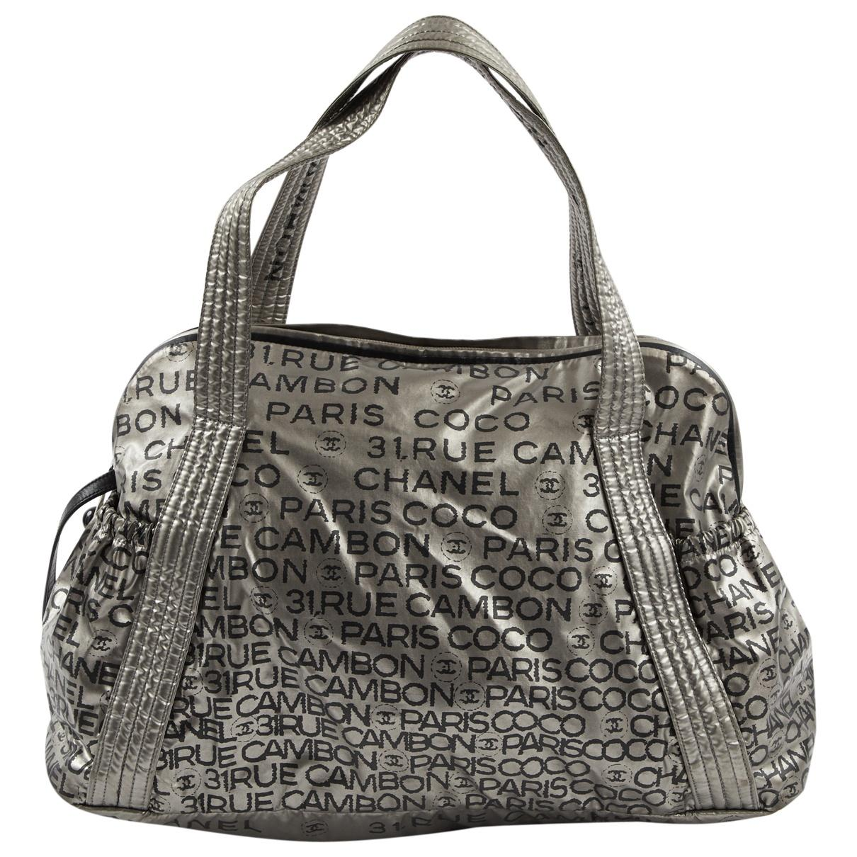 f7ce7ade48cc Lyst - Chanel Pre-owned Silver Cloth Handbags in Metallic