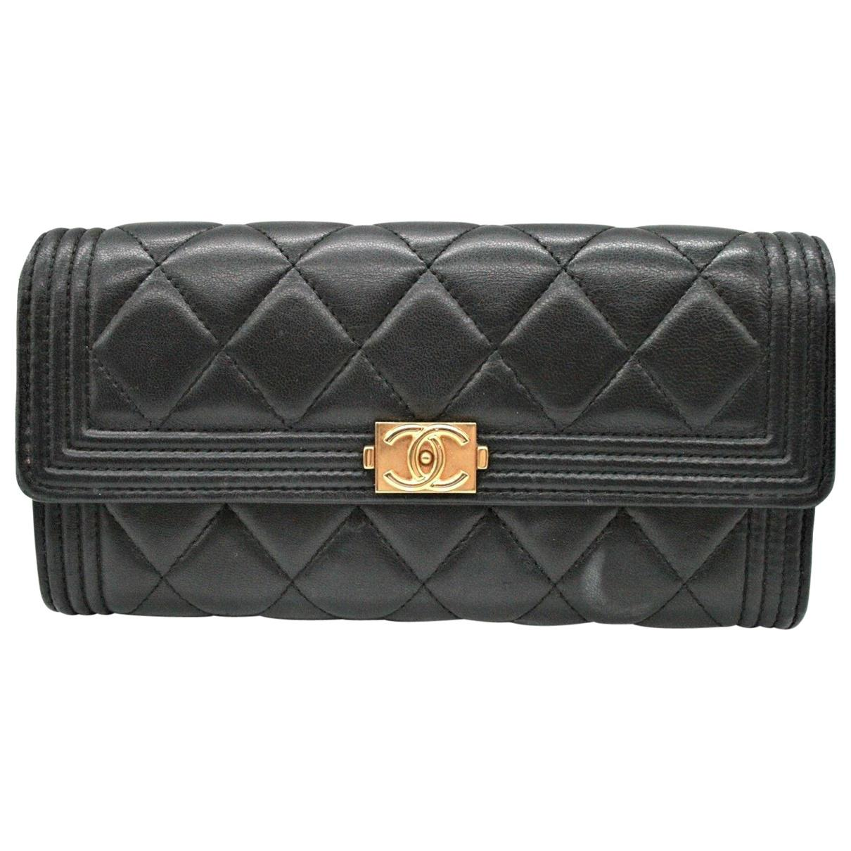 621f45641e0a Chanel. Women's Boy Black Leather Clutch Bag. $1,800 From Vestiaire  Collective