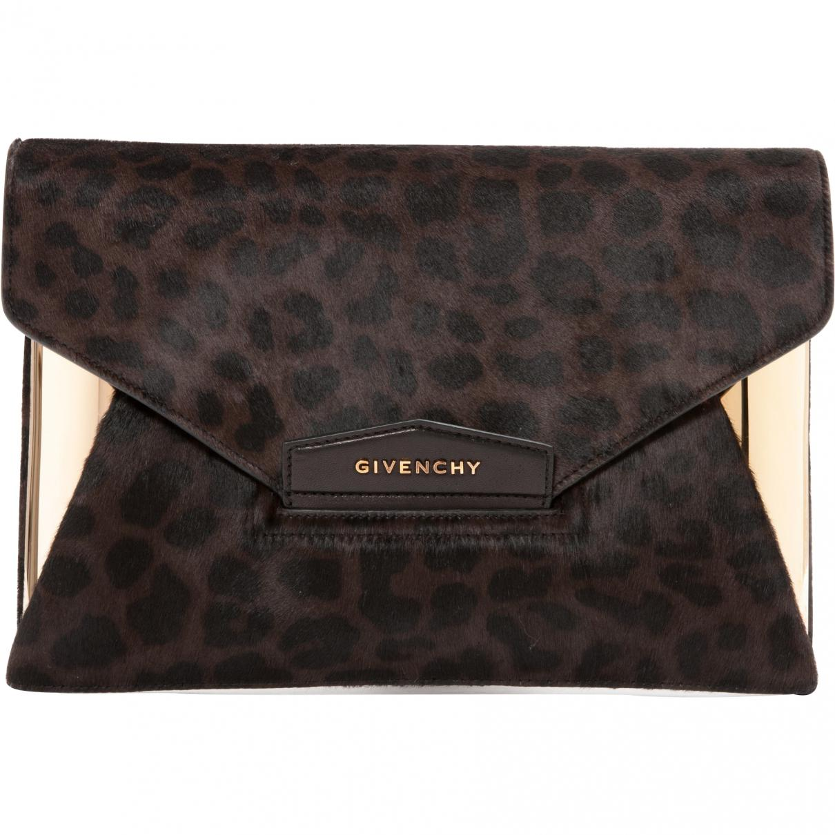 Givenchy Pre-owned Brown Pony-style Calfskin Clutch Bags in Brown - Lyst 4e1b960258d58