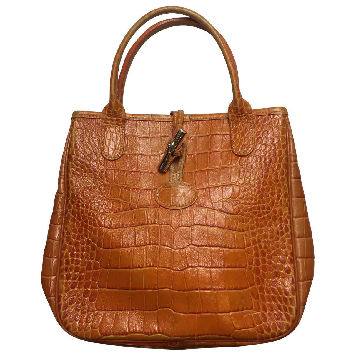 0248c93b8264 Lyst - Longchamp Roseau Leather Handbag in Orange