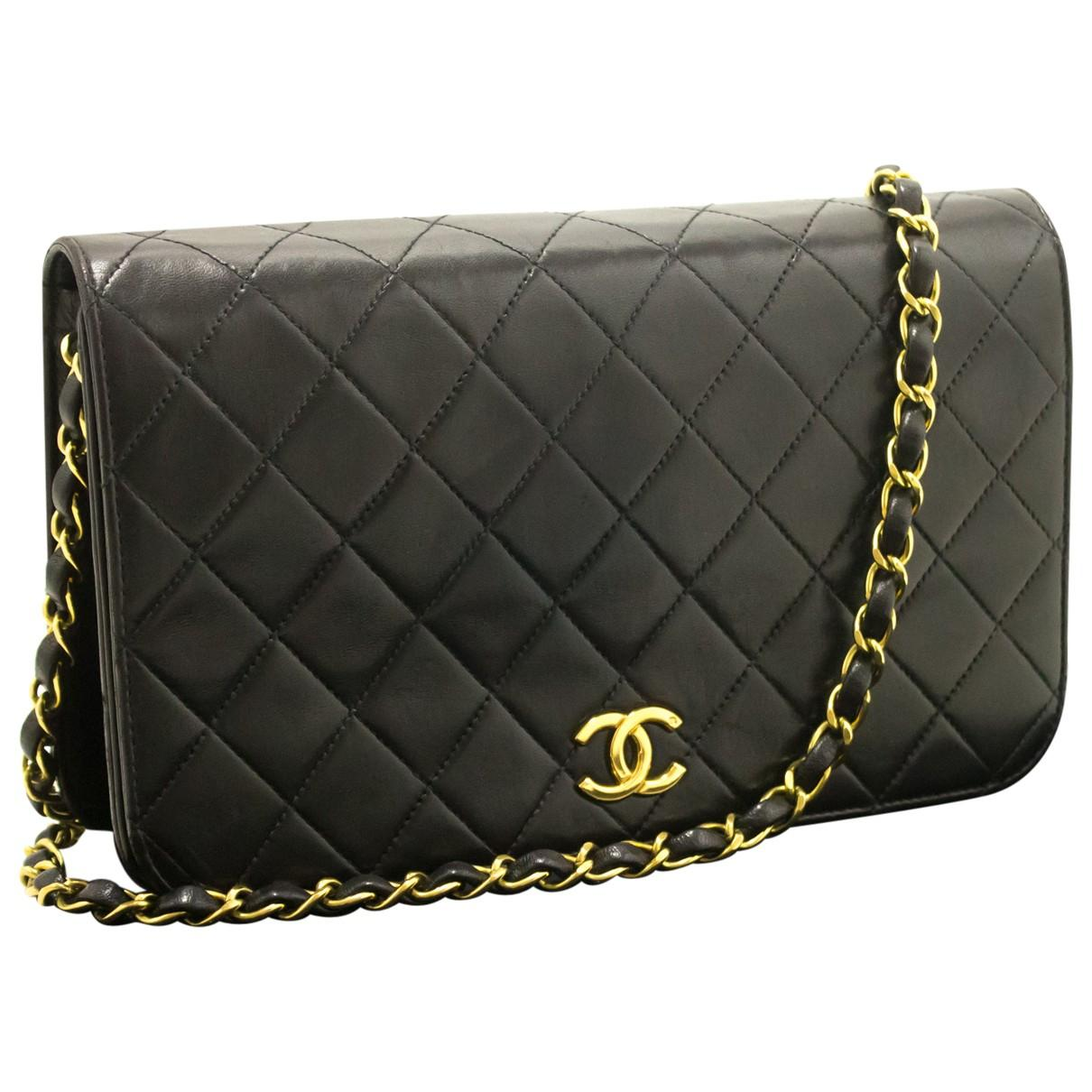 484100248bdb Chanel. Women's Pre-owned Vintage Black Leather Clutch Bag. $1,897 From Vestiaire  Collective