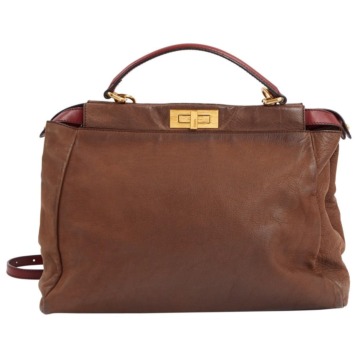 5d72a0352a04 Lyst - Fendi Pre-owned Peekaboo Brown Leather Handbags in Brown