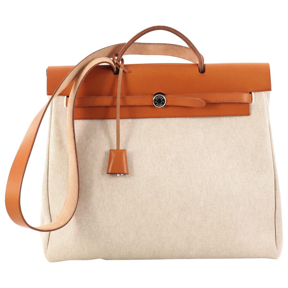 c12362b870b3 Lyst - Hermès Pre-owned Herbag Leather Handbag in Brown