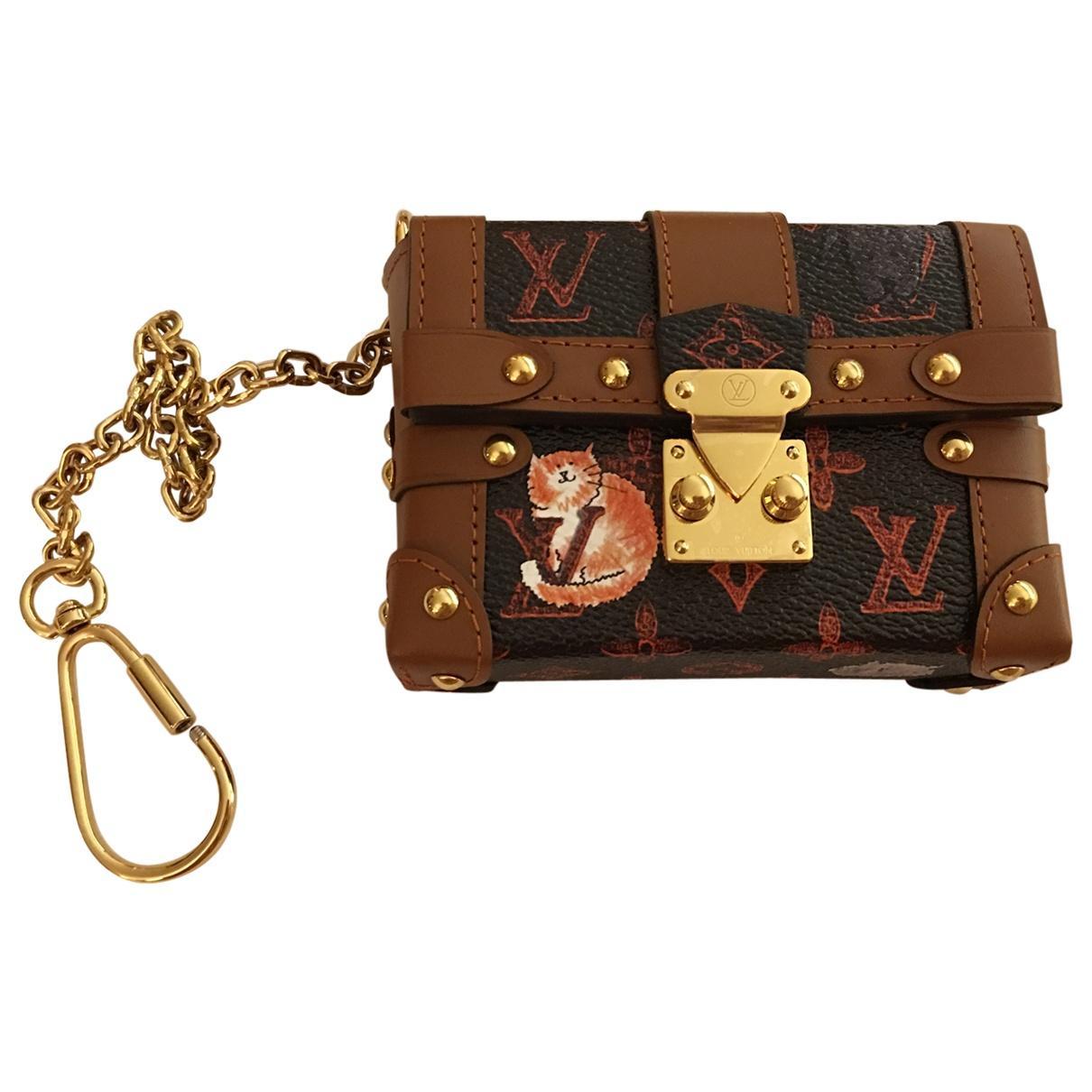 b64e9adb15dc Lyst - Louis Vuitton Essential Trunk Cloth Clutch Bag in Brown