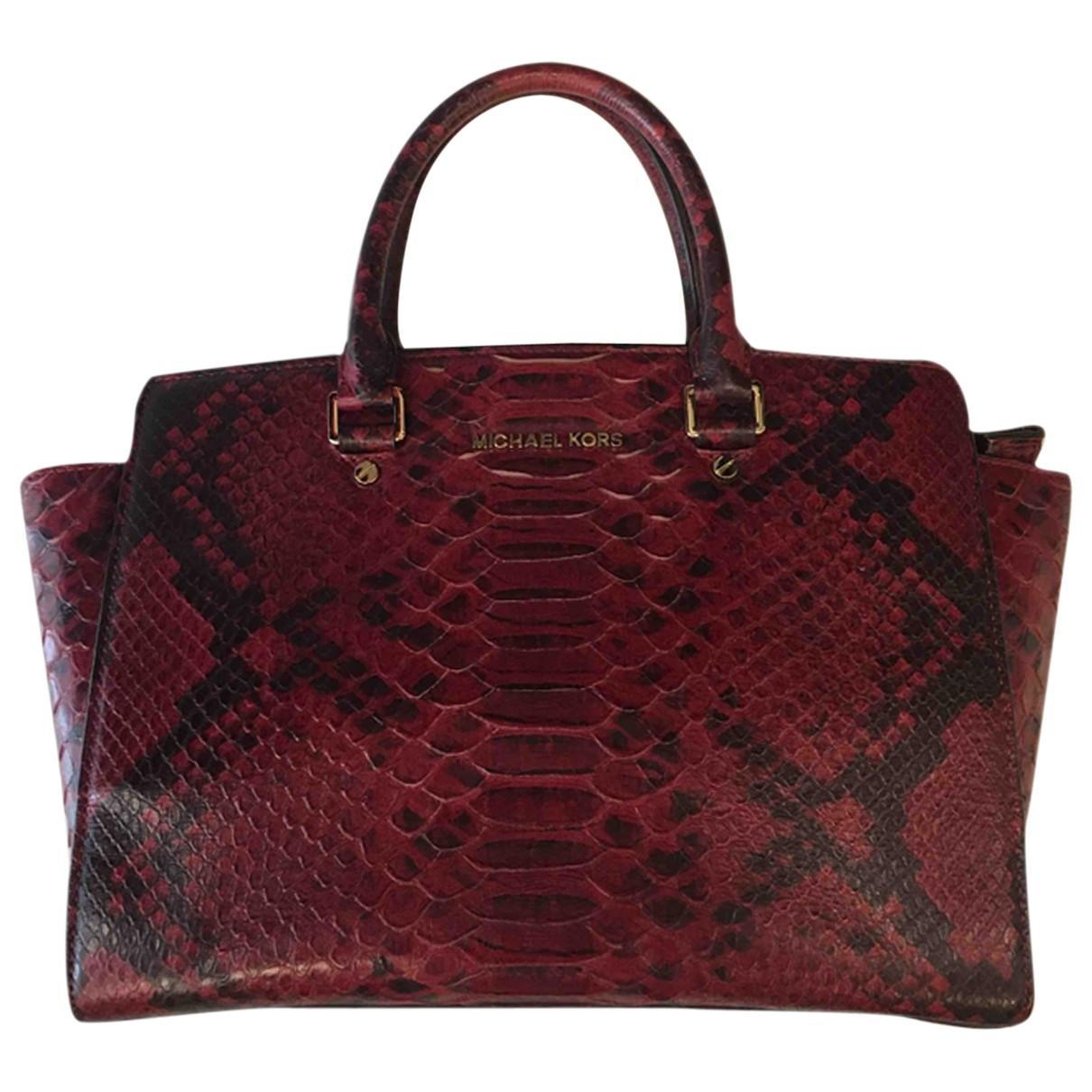 ... Burgundy Python Handbag - Lyst. View fullscreen d735e63b77599