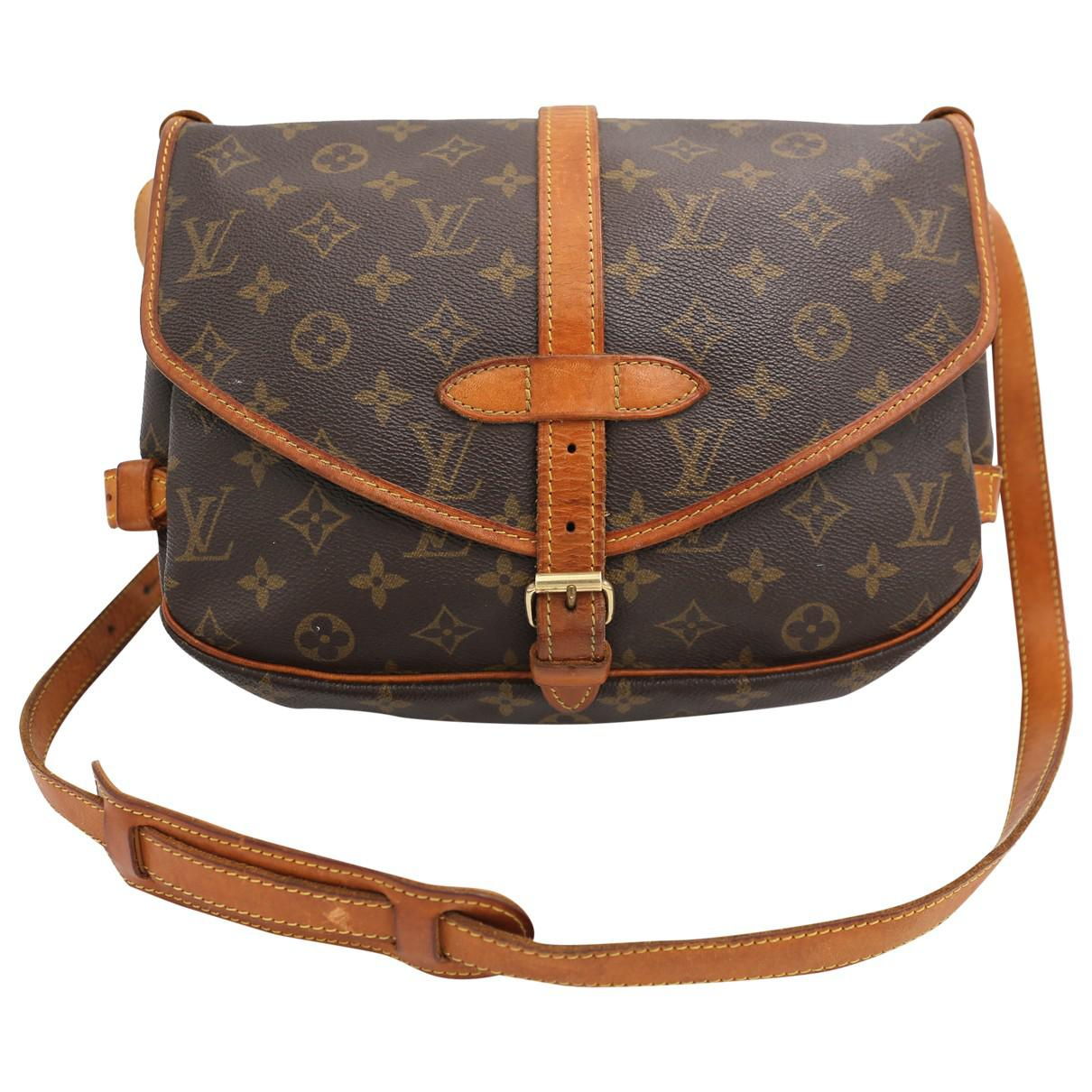 bfabe731e3b4 Lyst - Louis Vuitton Saumur Cloth Crossbody Bag in Brown