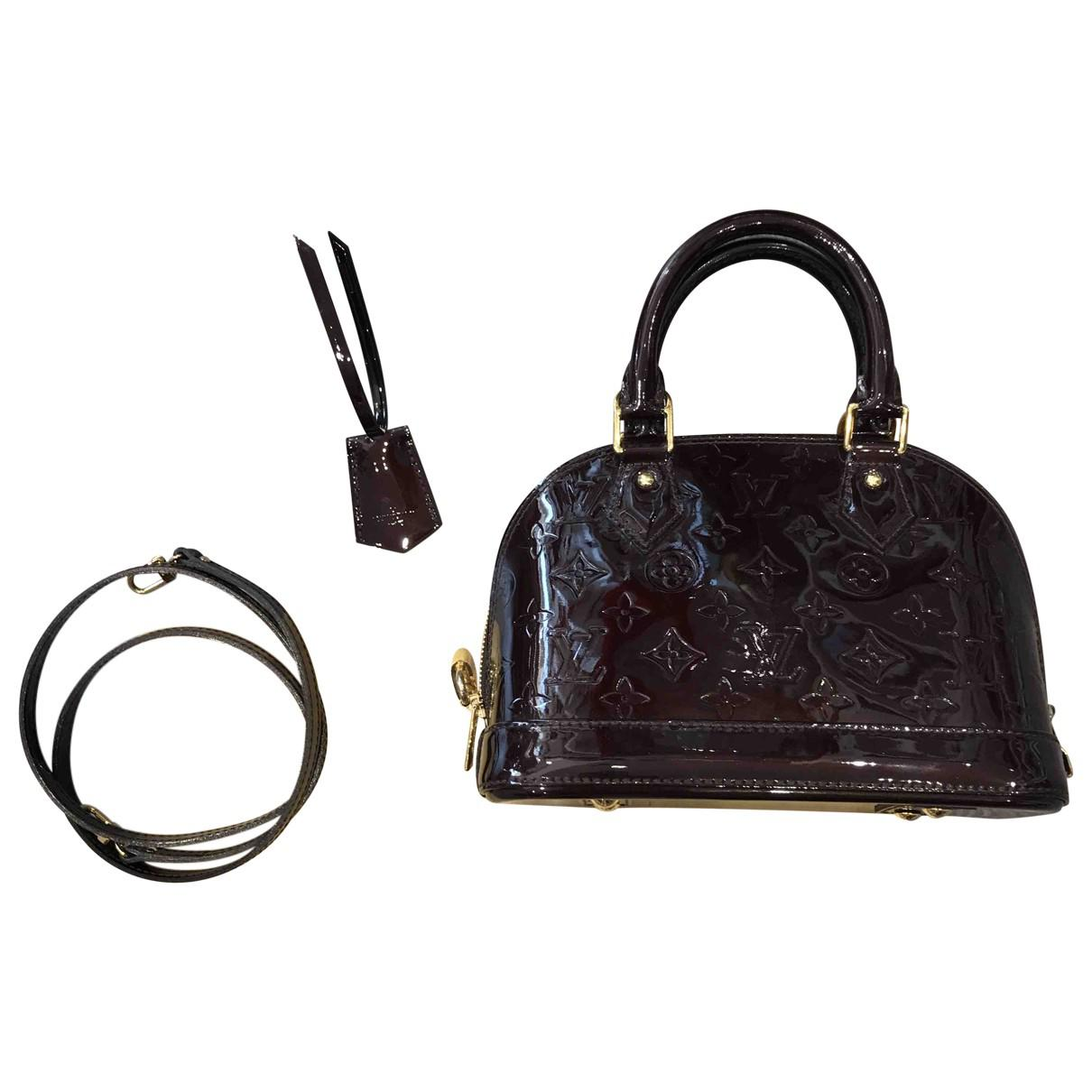 b407526bc23d Lyst Louis Vuitton Alma Bb Patent Leather Crossbody Bag In Black