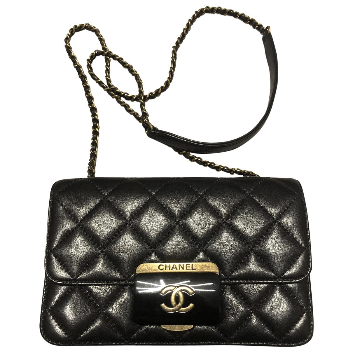Lyst Chanel Pre Owned Black Leather Handbags In Black
