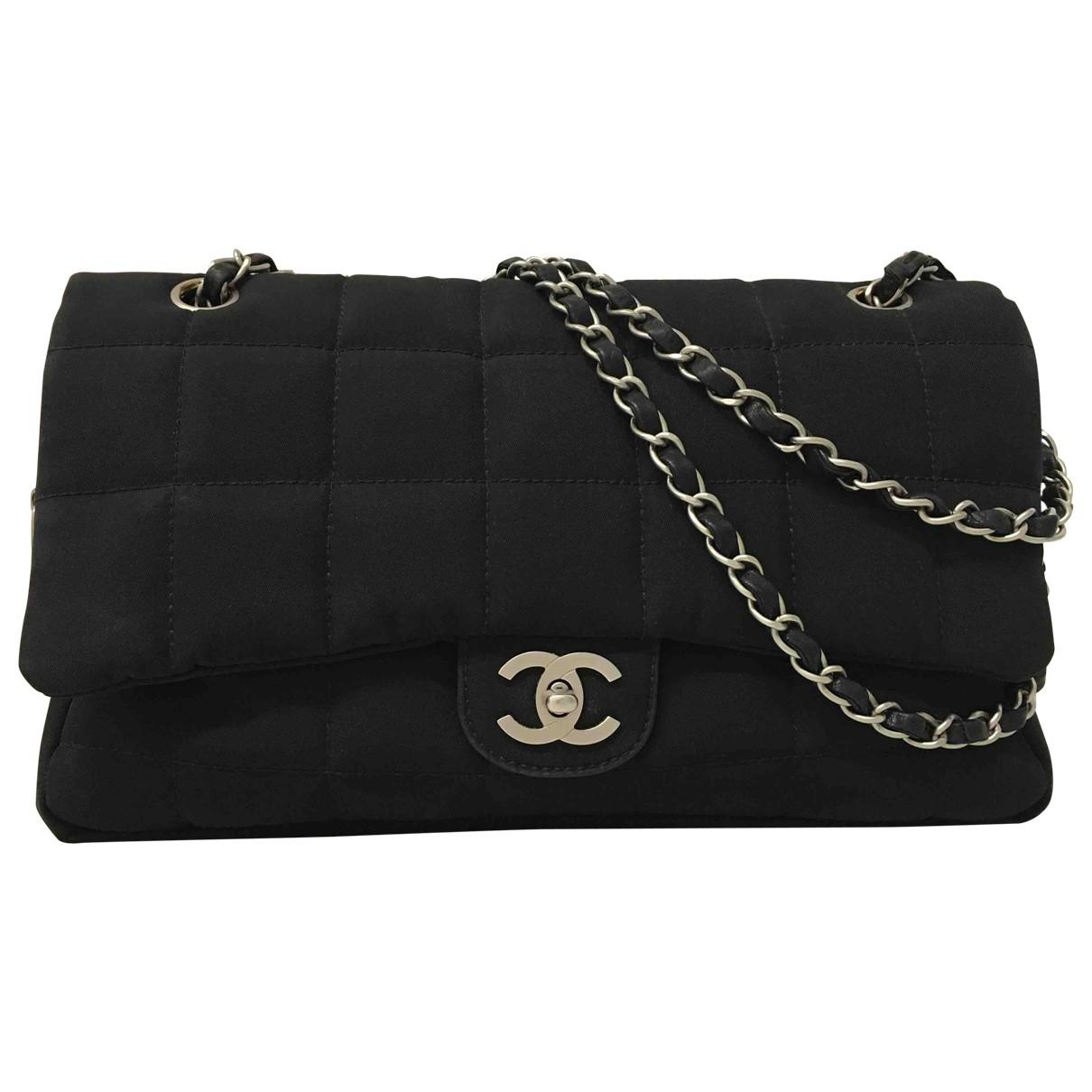 666a84c2a179 Chanel. Women s Black Timeless Cloth Handbag.  1,932  1,522 From Vestiaire  Collective ...