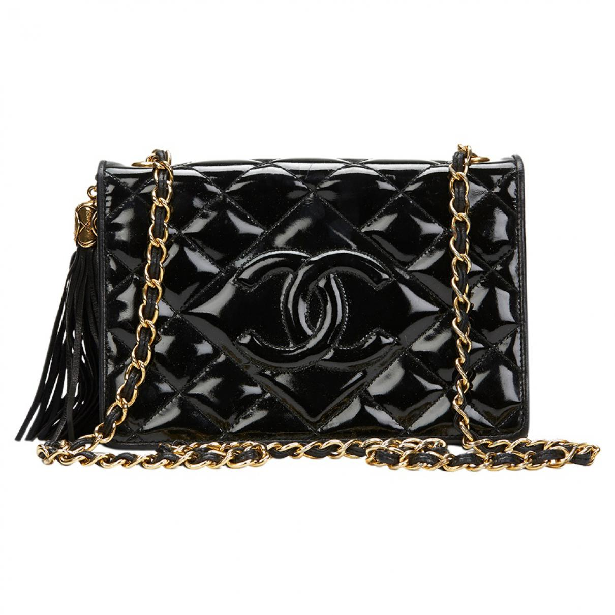 0309cc2f1112 Chanel Patent Leather Handbag in Black - Lyst