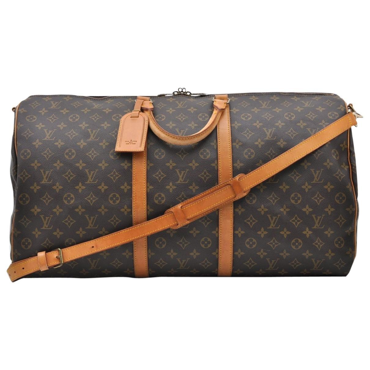 b3f8a352b46ff Lyst - Louis Vuitton Keepall Cloth Travel Bag in Brown
