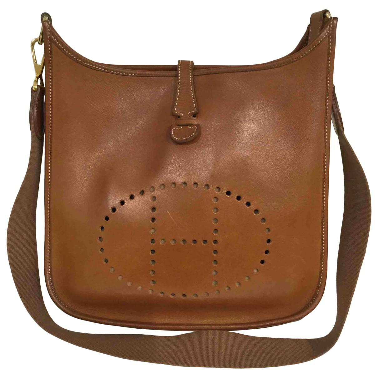 1e80bcd78d Lyst - Hermès Pre-owned Evelyne Leather Handbag in Brown