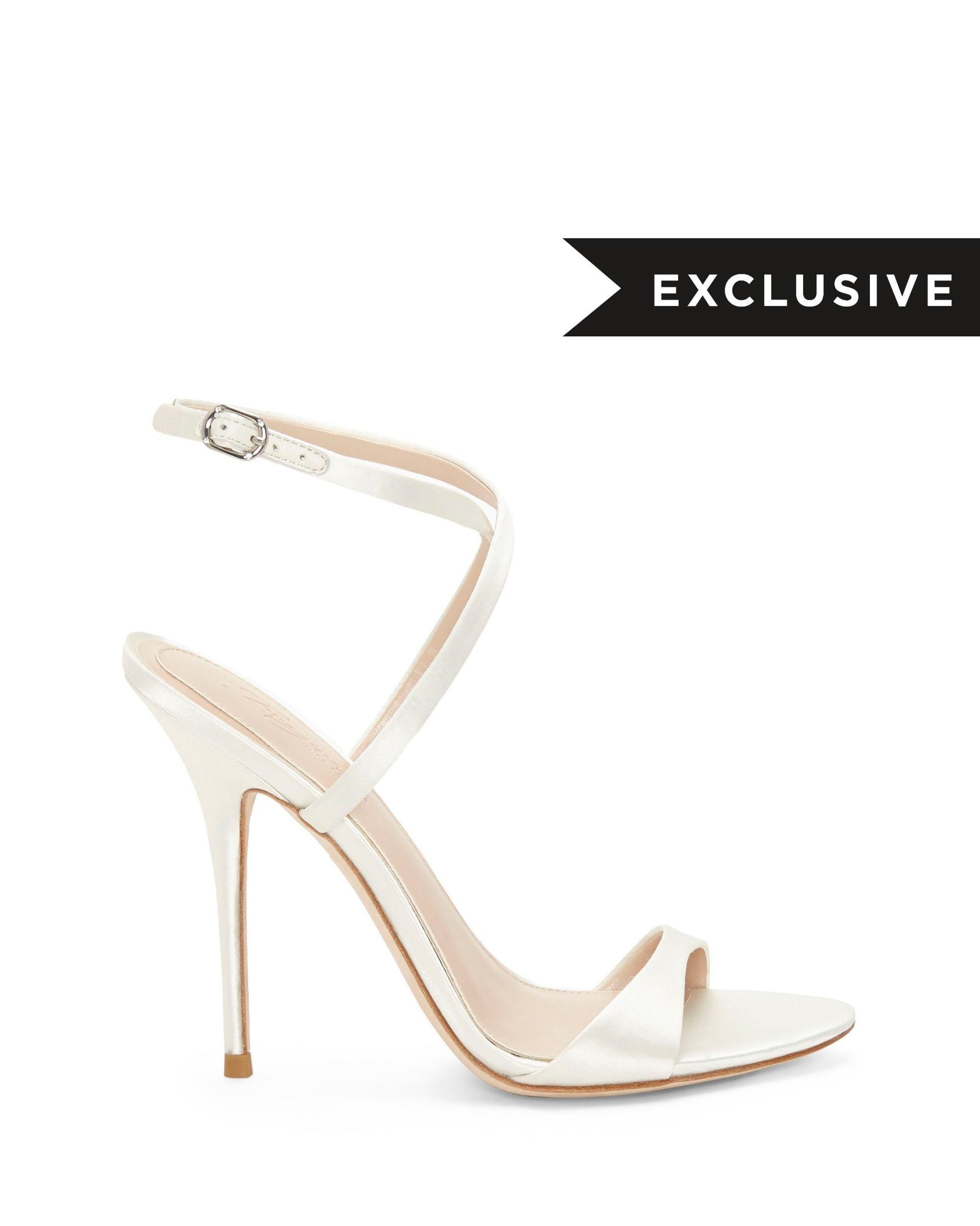 c569896812dd Lyst - Vince Camuto Imagine Rora – Crisscross-strap Sandal in White