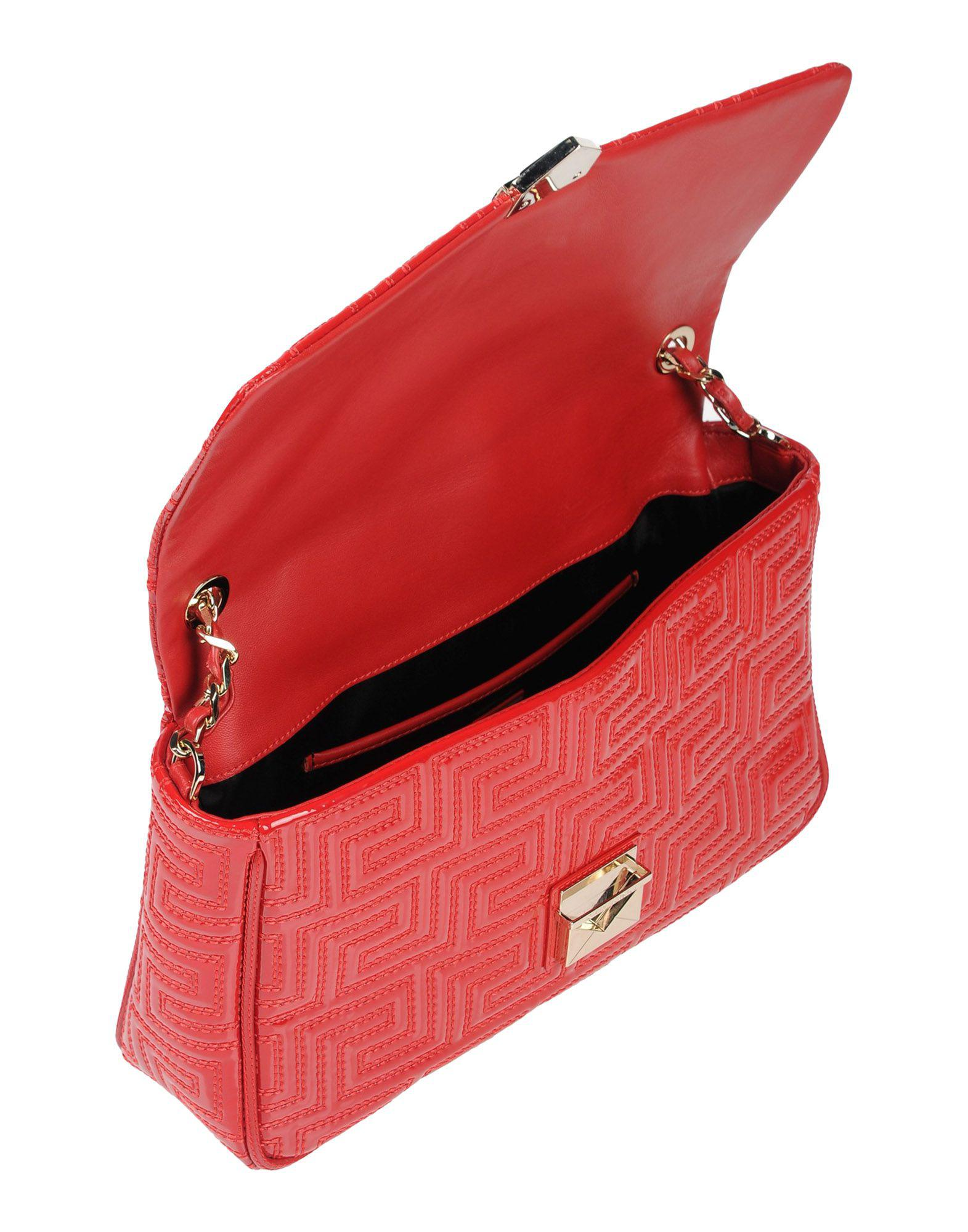 440990a362 Gianni Versace Couture - Red Handbags - Lyst. View fullscreen