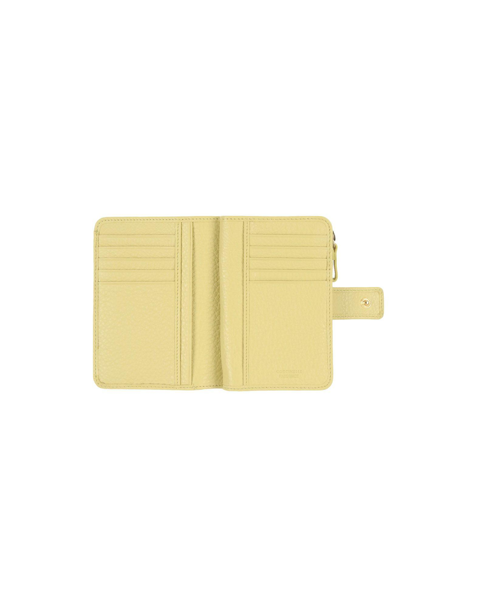 9ff92cd93c Lyst - Coccinelle Wallets in Yellow