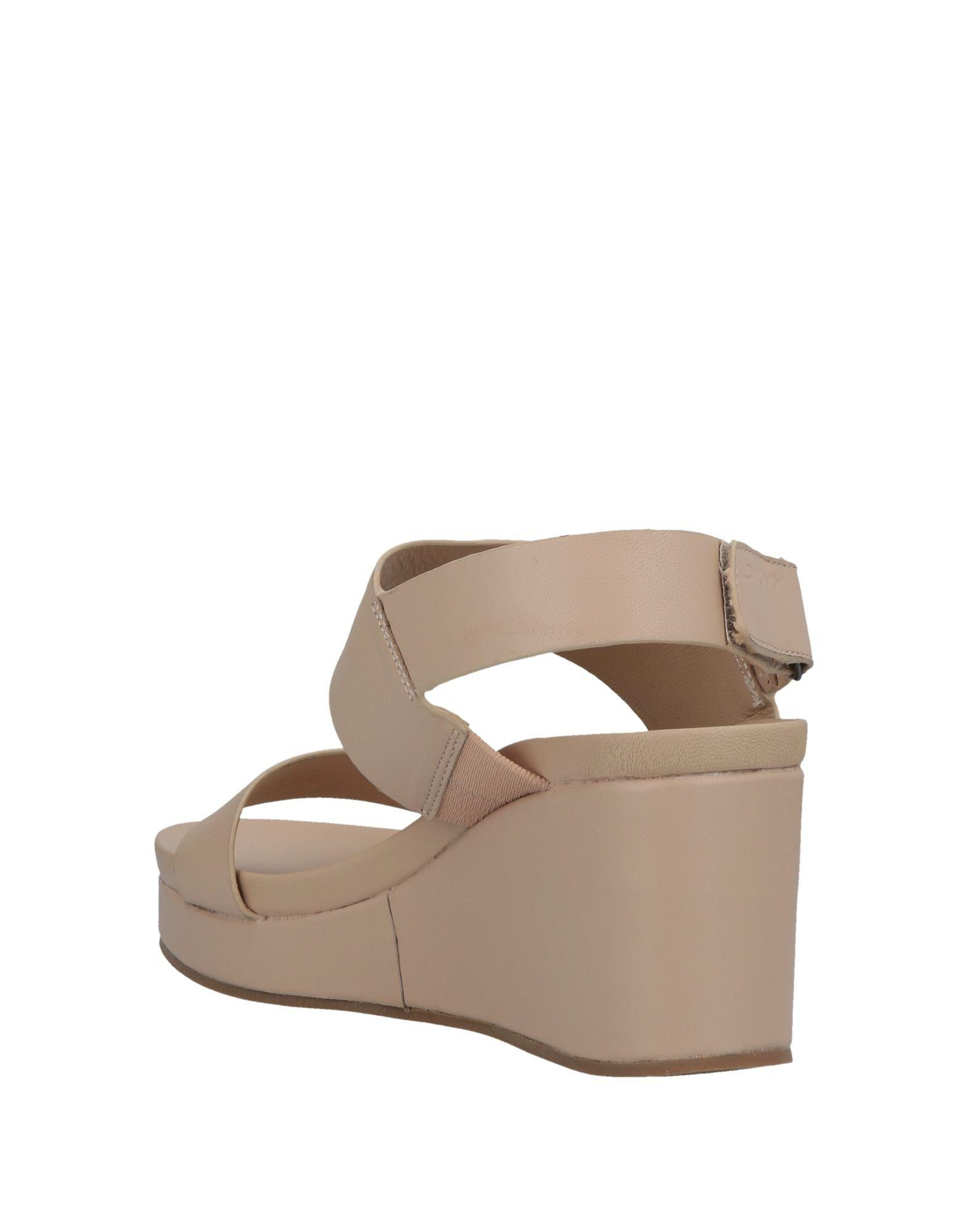36e90f6834d1 Lyst - Dkny Sandals