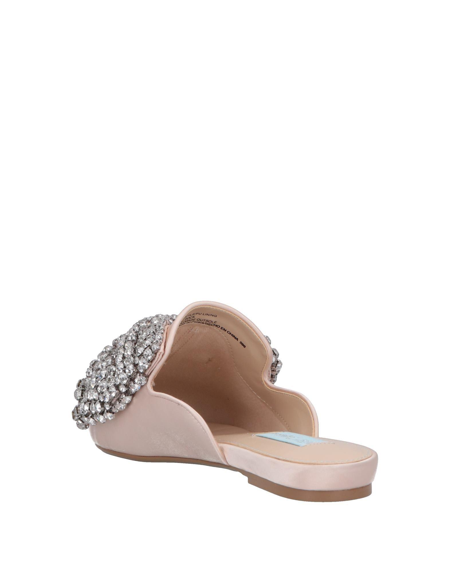 a58513edcdf9 Lyst - Betsey Johnson Mules in White
