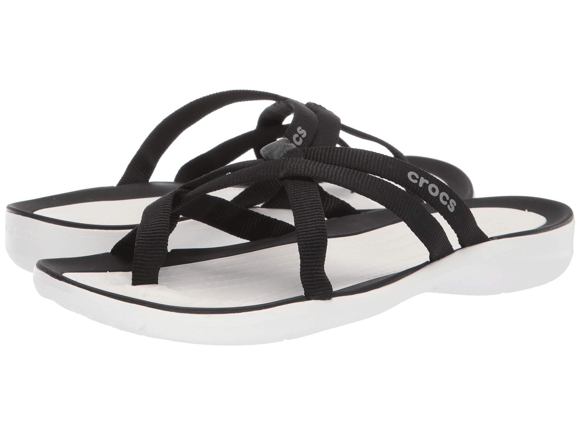 67ca064628af Lyst - Crocs™ Swiftwater Webbing Flip (black white) Women s Sandals ...