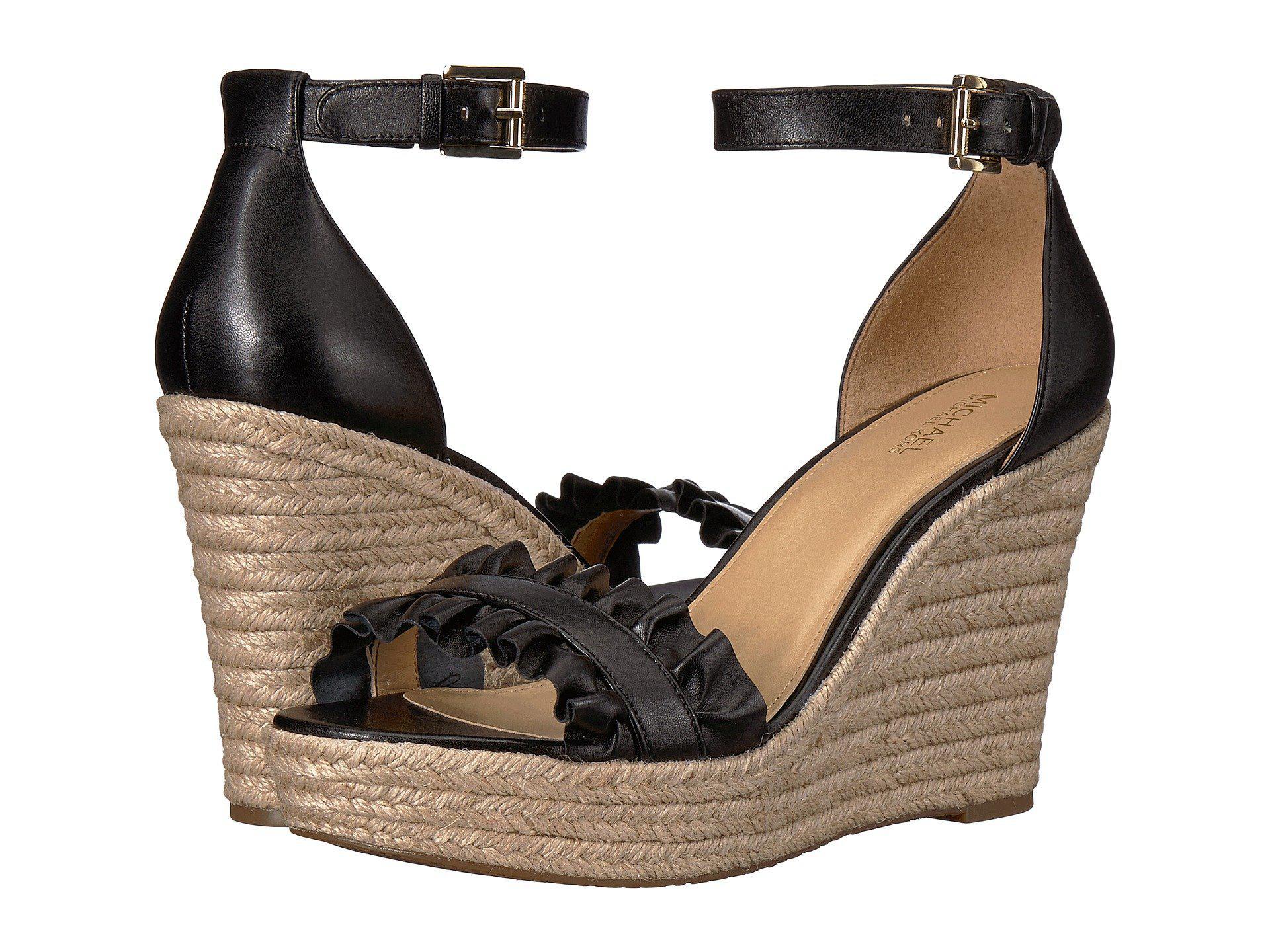 f5b0c8453e47 Lyst - MICHAEL Michael Kors Bella Wedge Sandal in Black