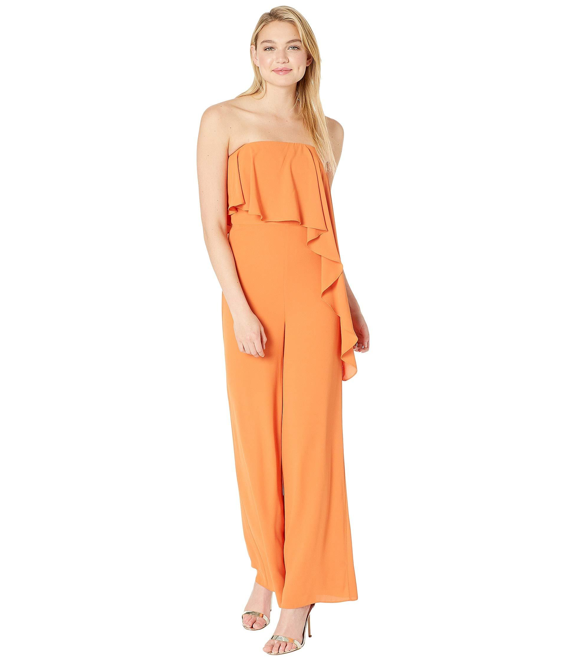 d8f0c5a604e3 Halston. Orange Strapless Wide Leg Jumpsuit With Flounce Overlay ...