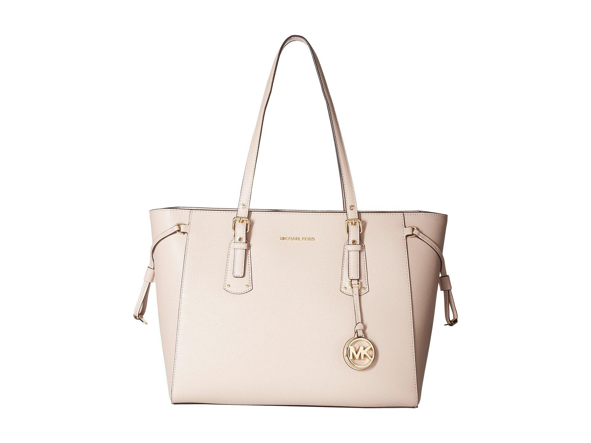 MICHAEL Michael Kors. Women s Voyager Medium Top Zip Tote (soft Pink) Tote  Handbags e0dee3b943090