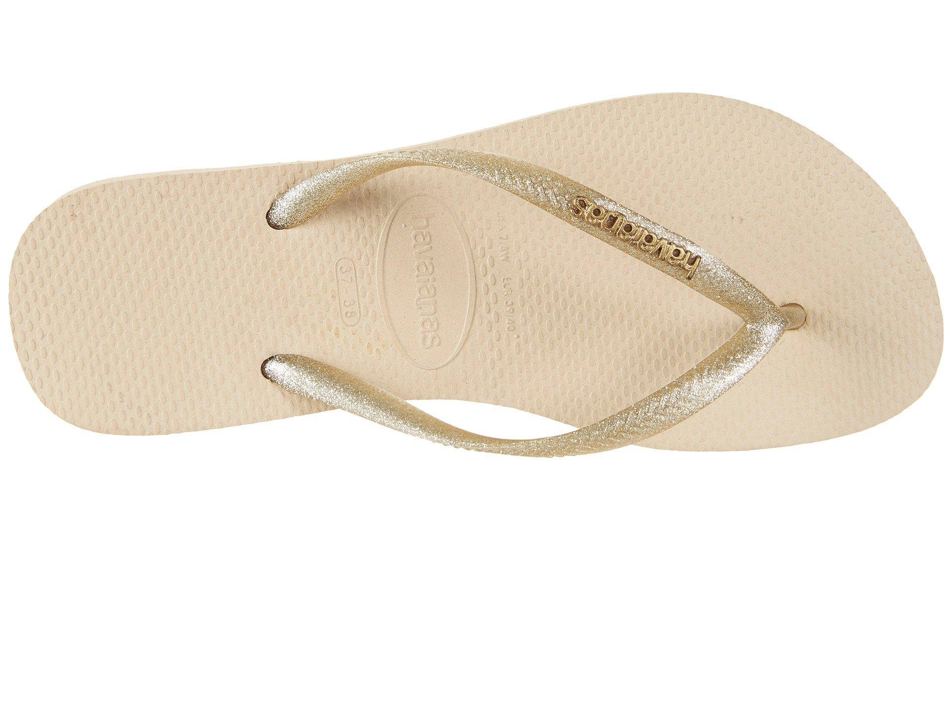 7b7bf7bdf18909 Havaianas - Slim Logo Metallic Flip Flops (white silver silver) Women s  Sandals. View fullscreen