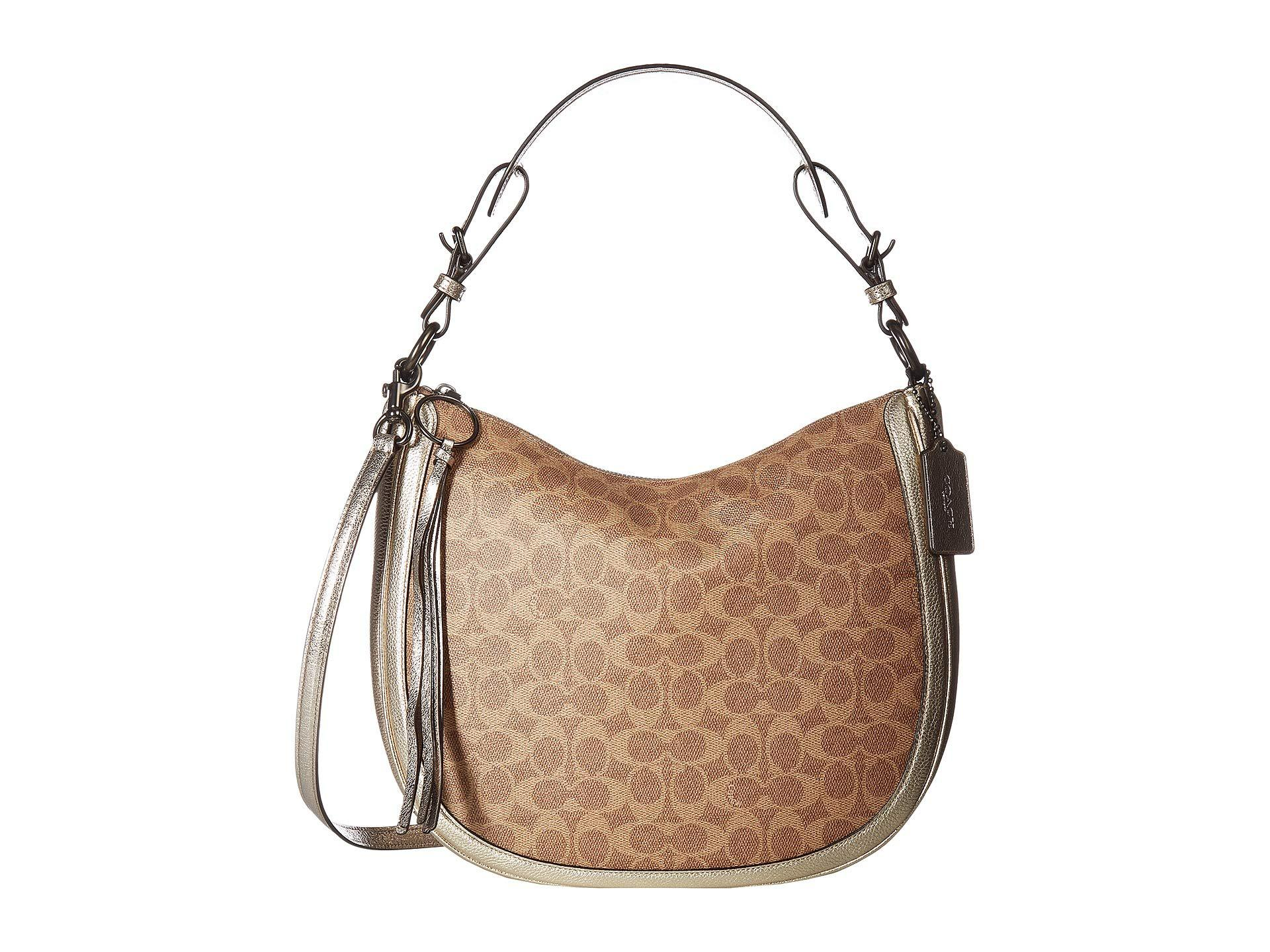Coach Women S Brown Coated Canvas