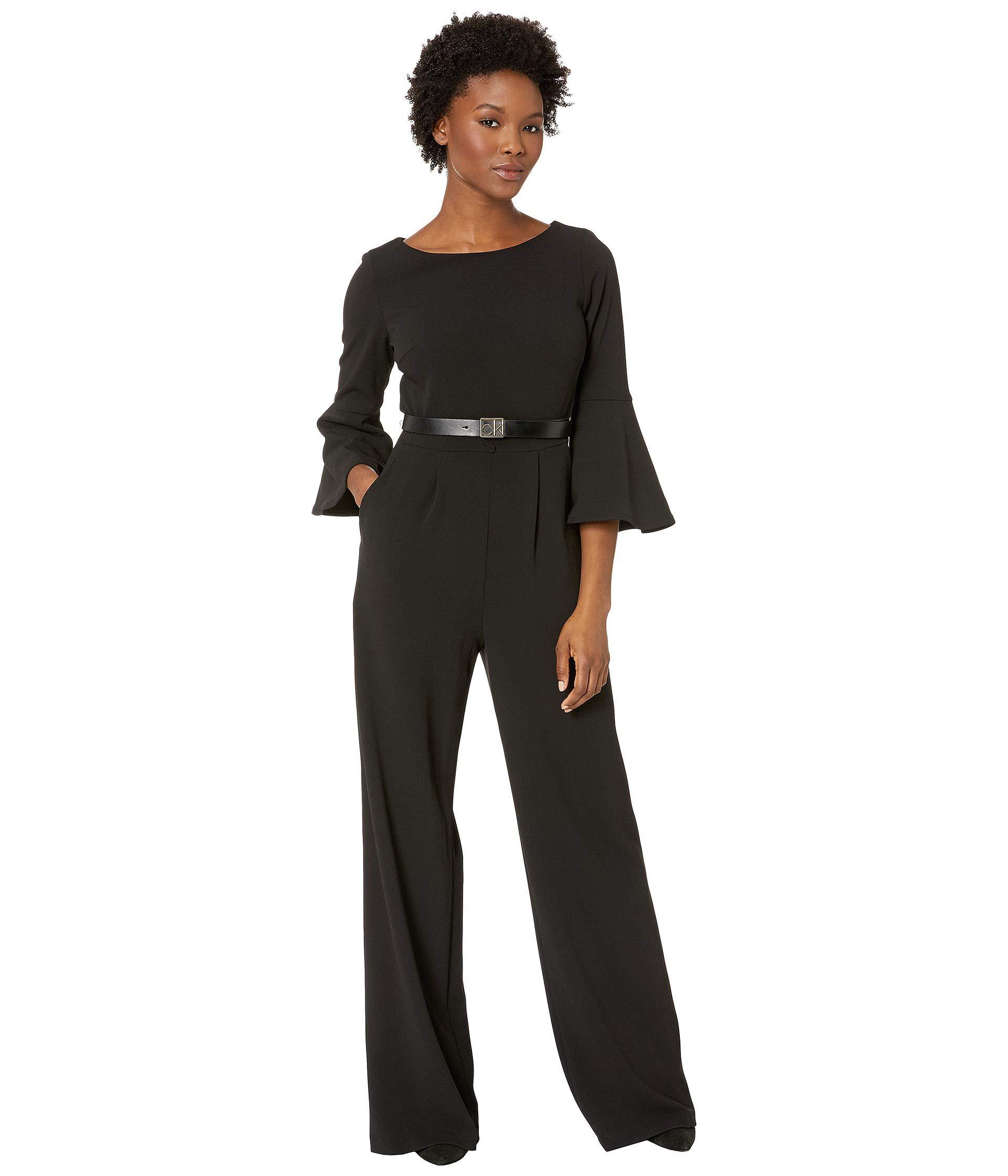 Lyst Calvin Klein Three Quarter Bell Sleeve Belted Jumpsuit In Black