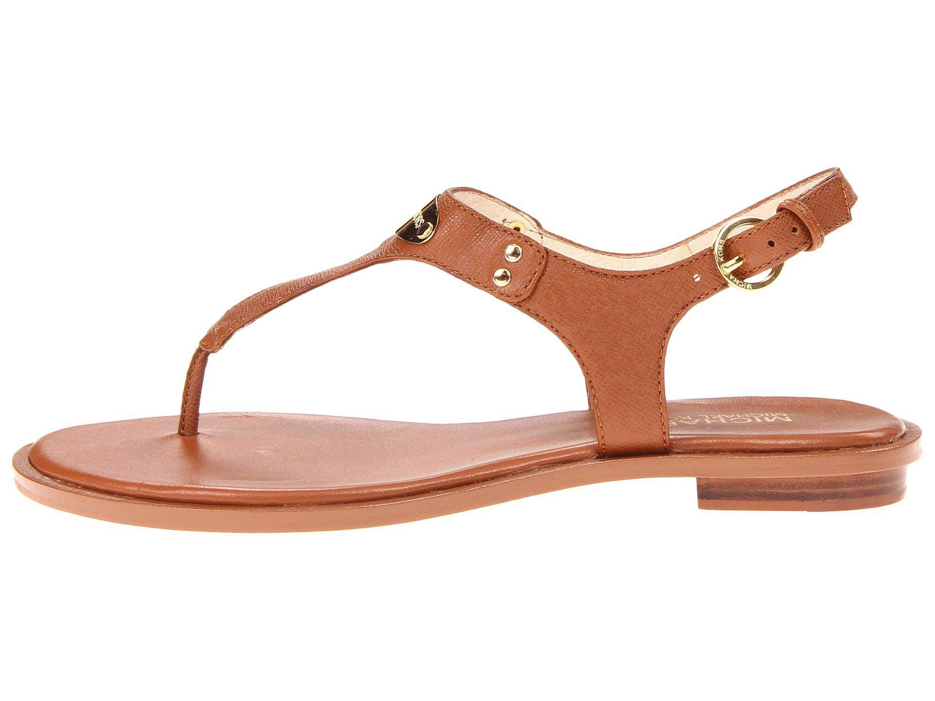 9e172e7c1f69 Lyst - MICHAEL Michael Kors Mk Plate Thong (navy Saffiano 1) Women s Sandals  in Brown - Save 38%